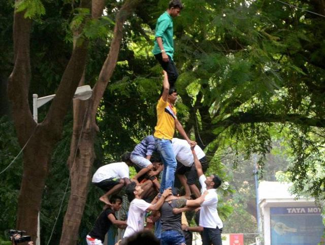 People make a human pyramid to protest against Supreme Court's order on restrictions on the Dahi Handi ritual, in Mumbai.