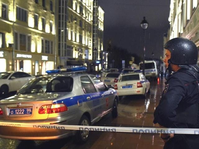 Policemen and officials in front of a City bank office in Moscow, where a man had taken four people hostage.