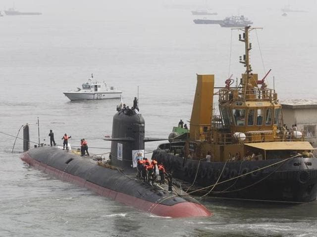 File photo of Indian Navy's Scorpene submarine INS Kalvari being escorted by tugboats as it arrives at Mazagon Docks Ltd, a naval vessel ship building yard, in Mumbai.