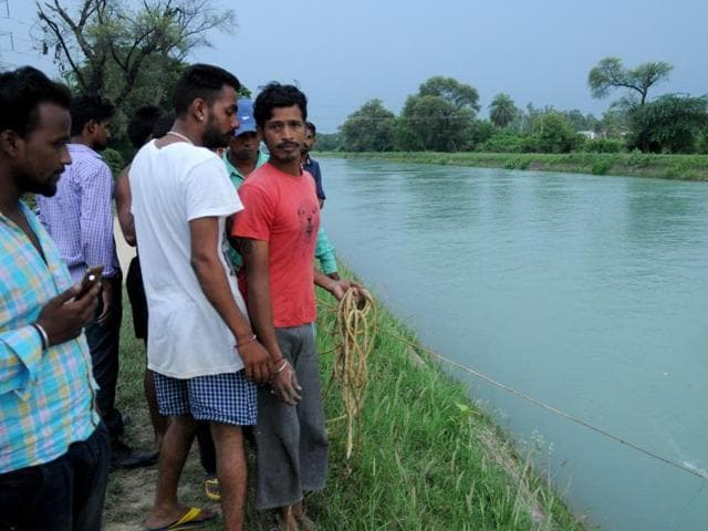 People at the spot where the car plunged into the Bhakra Canal in Patiala on Wednesday.
