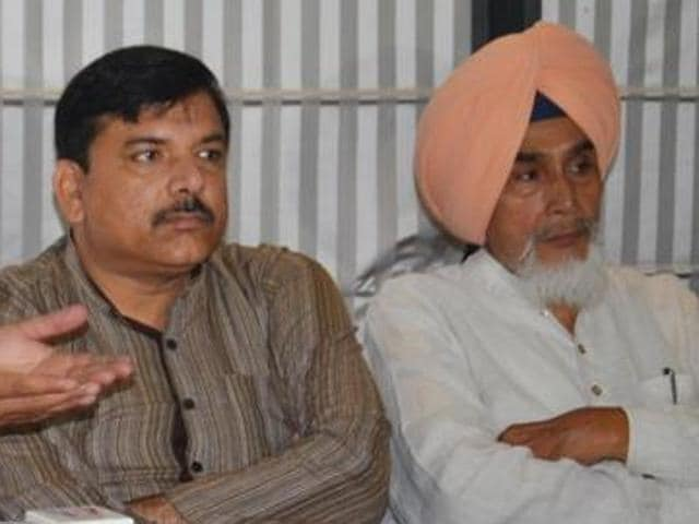 AAP Punjab affairs in-charge Sanjay Singh and Sucha Singh Chhotepur, who has been sacked from the post of state convener.
