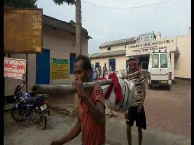 People carrying the body of Taramani Barik, an 85-year-old widow, who died after she was run over by a goods train near Soro railway station in Balasore district.