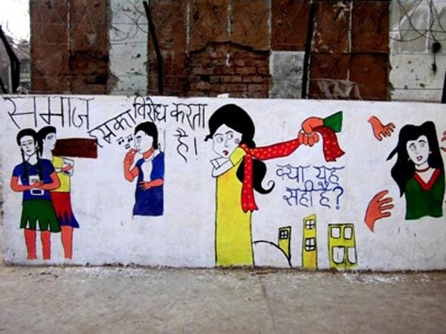 A wall painting by volunteers taking part in Gender Mela, depicting various restrictions and fears a woman faces on a daily basis.