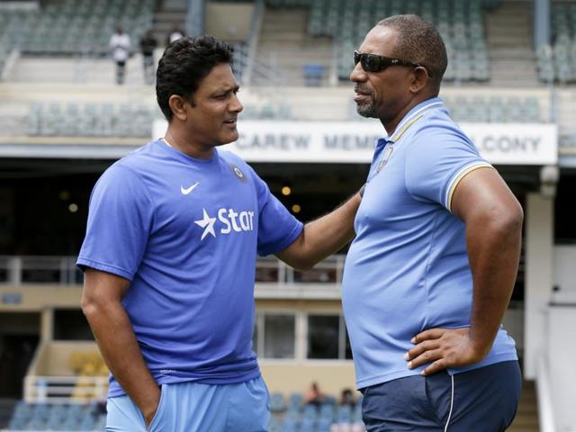 India's cricket team head coach Anil Kumble, left, and West Indies' coach Phil Simmons.