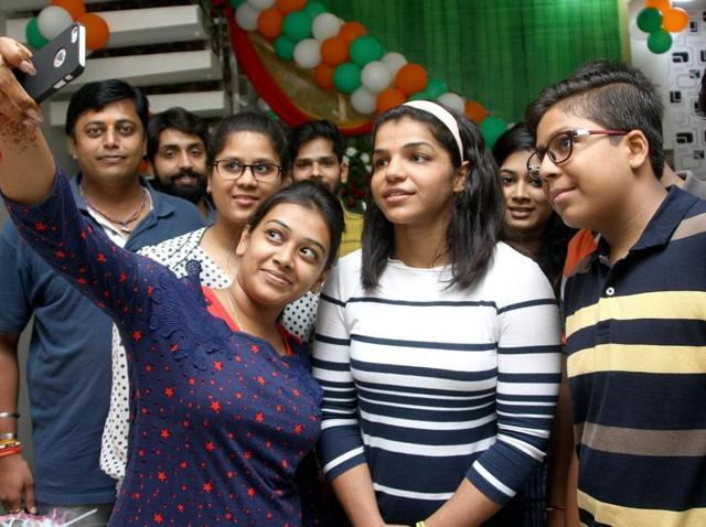 Youngsters taking a selfie with Rio bronze medallist wrestler Sakshi Malik in Rohtak on Thursday.