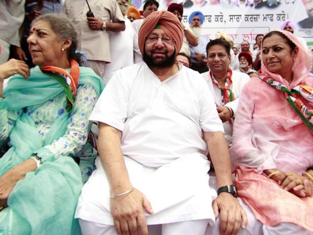 From left: Congress Punjab campaign committee head Ambika Soni, state unit chief Capt Amarinder Singh, central in-charge Asha Kumari,  and senior leader Rajinder Kaur Bhattal during a protest rally against the SAD-BJPgovernment at Gurdaspur on Friday.