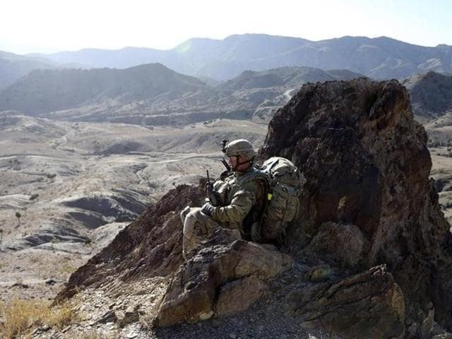 A US soldier observes the area from a hill top near the town of Walli Was in Paktika province, near the border with Pakistan.
