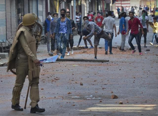 Kashmiri protesters throw bricks and stones at the security forces in Srinagar. The cycle of violence has claimed so far 67 lives.