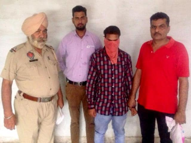The accused in police custody on Thursday.