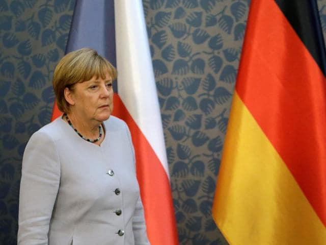 German Chancellor Angela Merkel arrives at a news conference at Czech government headquarters in Prague, Czech Republic.