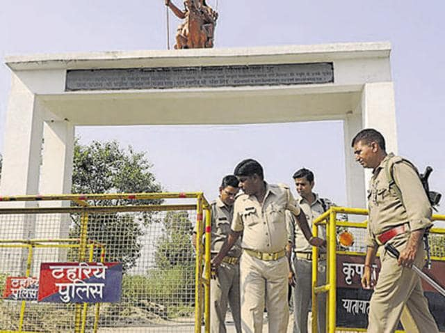 Policemen at the entrance of Bisada village, where Mohammad Ikhlaq was lynched in Dadri.