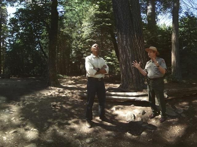 In this file photo provided by Felix & Paul Studios, US President Barack Obama and Yosemite Superintendent Don Neubacher talk during Obama's visit to Yosemite National Park in California.