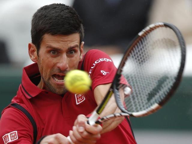 A file photo of Serbia's Novak Djokovic returning the ball to Austria's Dominic Thiem.
