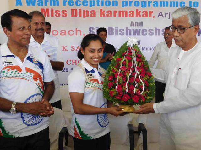 Tripura Chief Minister felicitates Dipa Karmakar after her homecoming at Swami Vivekananda Stadium.
