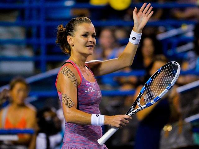 Agnieszka Radwanska of Poland returns a shot to Petra Kvitova of the Czech Republic on day 6 of the Connecticut Open.
