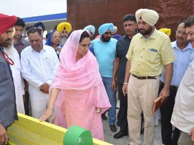 Union minister Harsimrat Kaur Badal and OSD Harendra Sra (yellow turban) checking the benches which were distributed during a sangat darshan in Mansa.