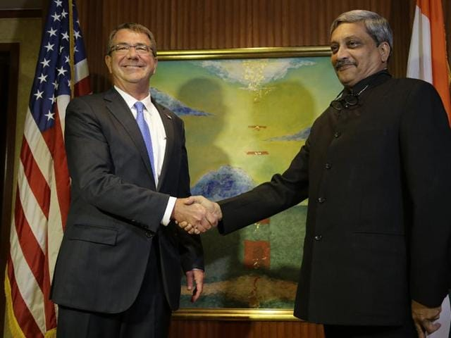 US Defense Secretary Ash Carter (left) meets with  Defence Minister Manohar Parrikar in Singapore in June this year. Parikkar is scheduled to hold his third meeting with Carter on Monday.