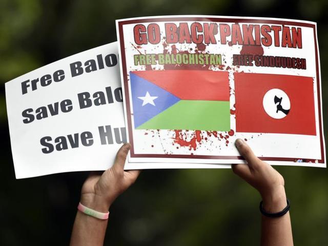 A demonstrator protests in support Balochistan at Jantar Mantar in New Delhi.
