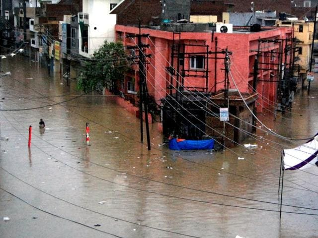 A waterlogged Sirki Bazaar in Bathinda on Saturday. (Sanjeev Kumar/HT Photo)
