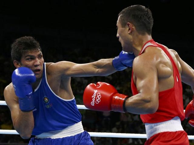 India's Vikas Krishan, right, fights Turkey's Onder Sipal during a men's middleweight 75-kg preliminary boxing match.