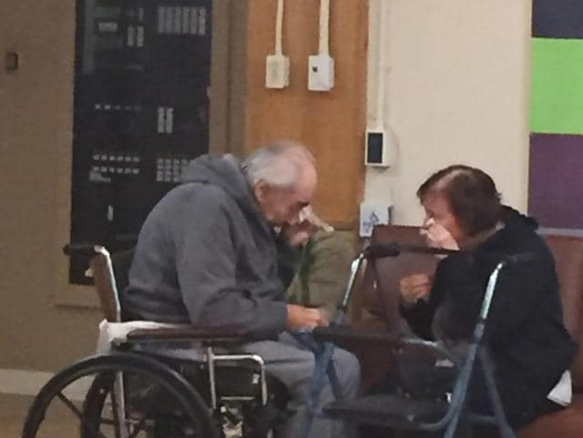 Wolfram and Anita Gottschalk of Surrey, British Columbia, Canada, cry as they say goodbye near the end of a visit in an elderly care home in Surrey.
