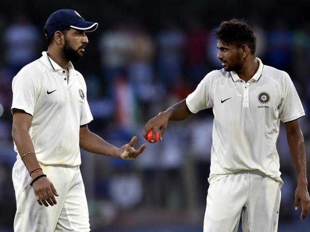 Yuvraj Singh handing over the ball to team bowler Nathu Singh during the match against India Green.