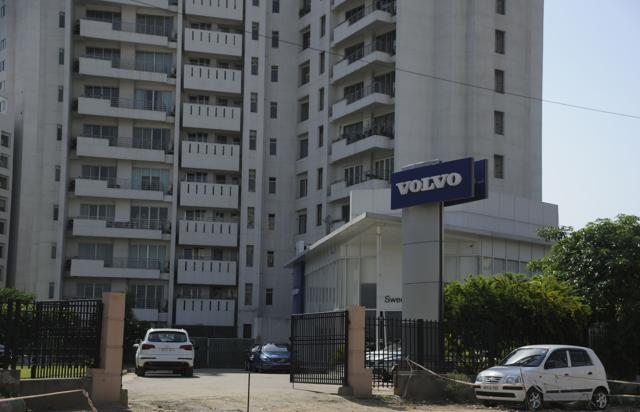 A car showroom at Parsvnath Exotica apartment's exit gate  in Gurgaon.