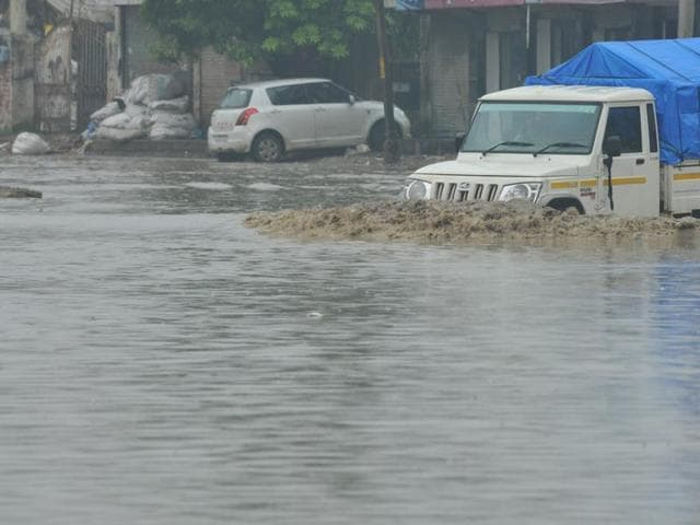 A waterlogged road in Jalandhar on Saturday. (Pardeep Pandit/HT Photo)