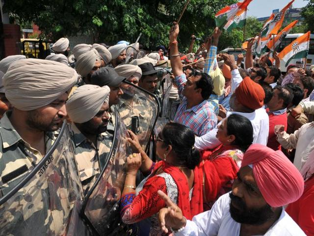Police stopping Congress protesters from entering the district administrative complex in Jalandhar on Friday.