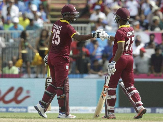 West Indies' Johnson Charles and Evin Lewis bump fists during the first Twenty20 international cricket match.
