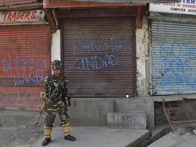 A soldier stands guard during a curfew in downtown Srinagar.