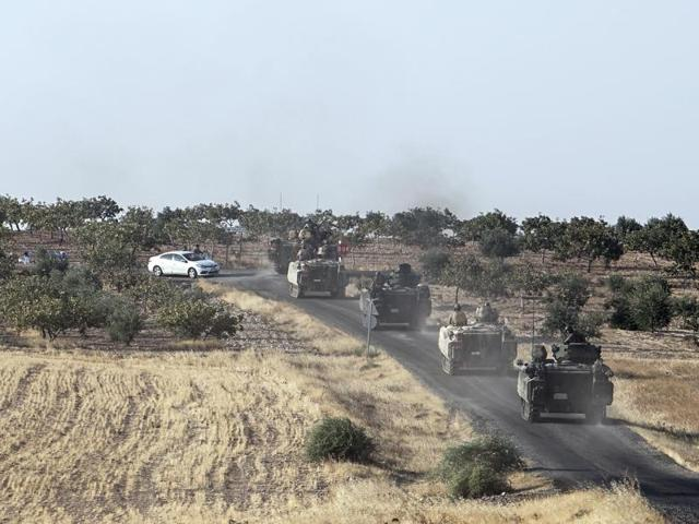 Turkish troops head to the Syrian border, in Karkamis, Turkey, on Saturday.
