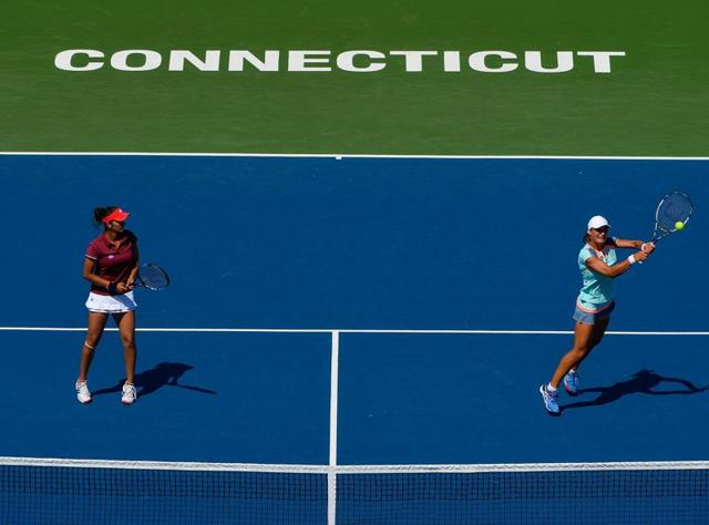 Sania Mirza and Monica Niculescu of Romania celebrate after defeating Kateryna Bondarenko and Chia-Jung Chuang in the doubles finals of the Connecticut Open late on Saturday.