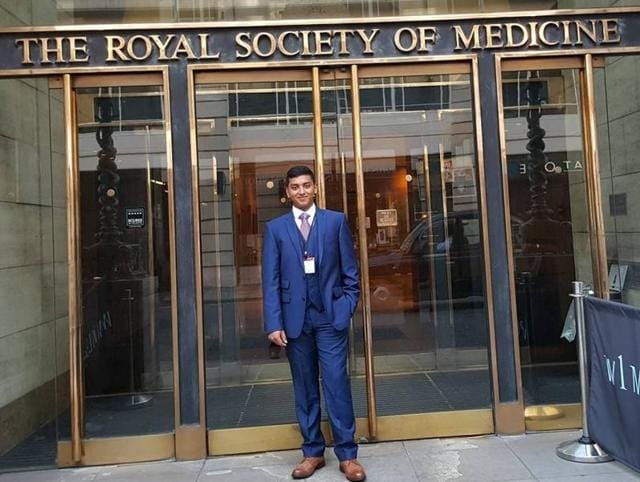 KrtinNithiyanandam poses for a photo outside The Royal Society of Medicine in London.
