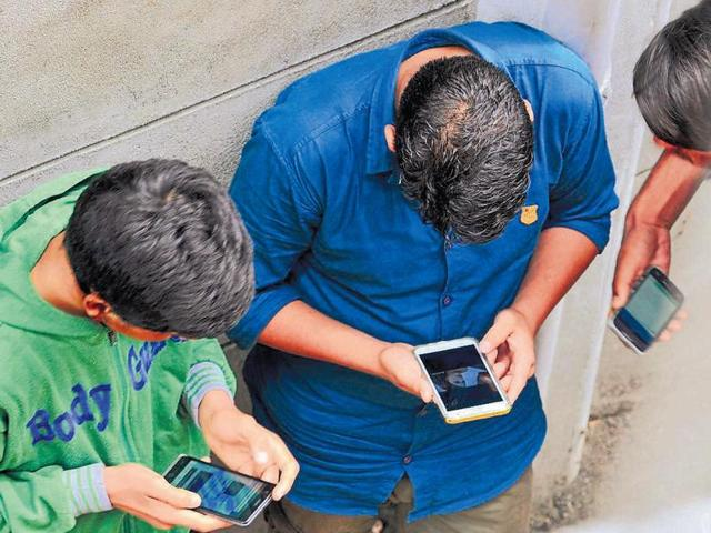 Youngsters surf the internet on their phones after hacking into a Wi-fi network in Srinagar as mobile internet remains suspended in the conflict-hit Kashmir.