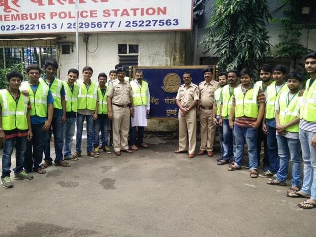 VESIT students helping policemen during dahi handi.
