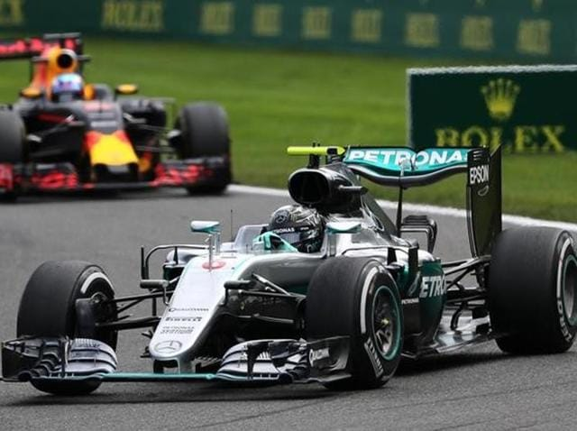 Nico Rosberg acknowledges his team members after crossing the finish line to win the Belgian Grand Prix.