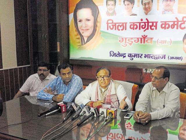 Senior Congress leader and former minister capt Ajay Yadav (centre) talks to the media on Saturday.