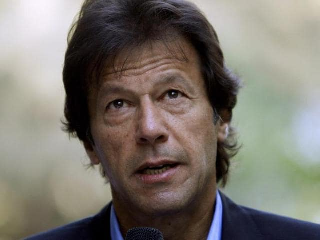 Cricket star turned Pakistani politician Imran Khan speaks during a news conference in Mumbai.