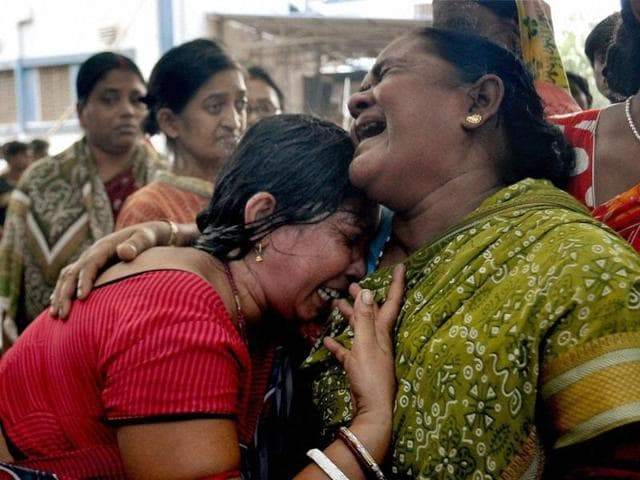 Women mourn the death of a relative killed in a fire accident at Murshidabad Medical College and Hospital.