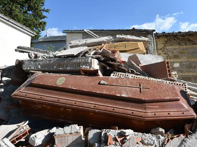 Damaged coffins and rubble at the cemetery of Sant'Angelo, 15km from the Italian village of Amatrice, three days after a 6.2-magnitude earthquake struck the region.