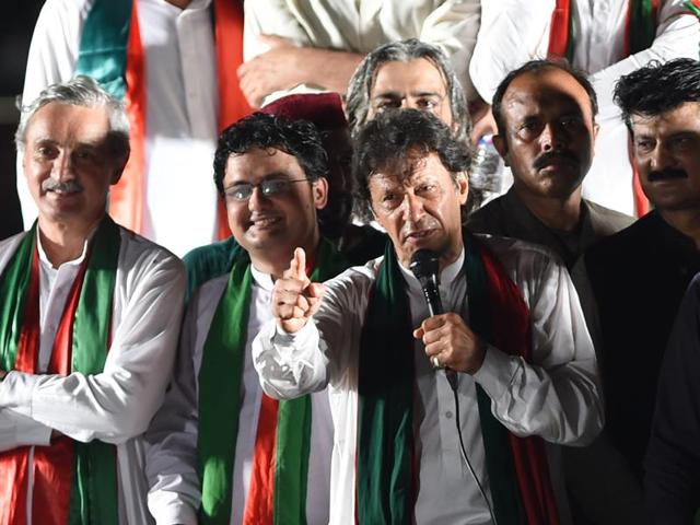 Imran Khan, the head of Pakistan Tehreek-e-Insaf addresses his supporters prior to leading an anti-government rally in Peshawar on August  7.