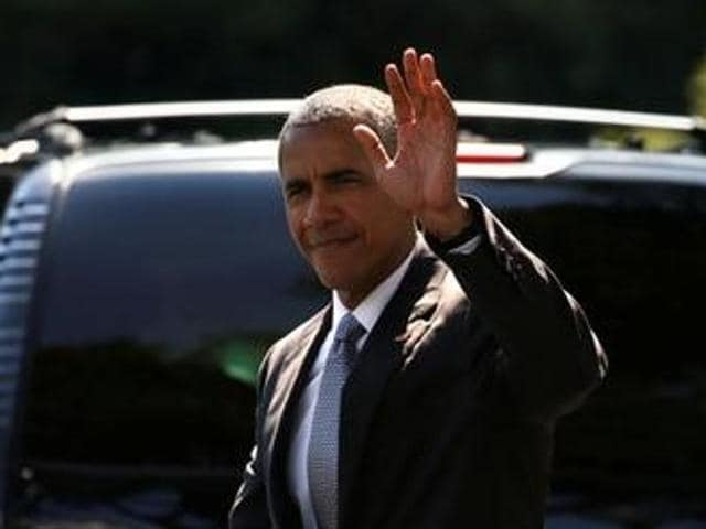 US President Barack Obama waves as walks on the South Lawn of the White House in Washington on Friday.