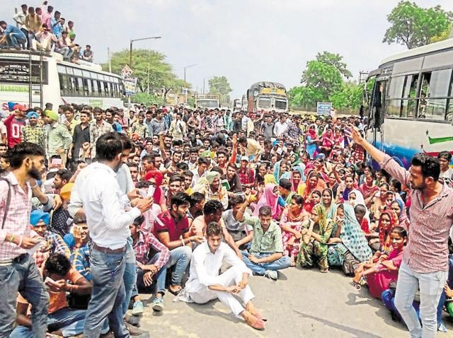 Students blocking the Mansa-Sirsa highway on Saturday.