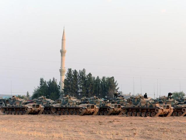 Turkish tanks stationed in Karkamis, Turkey, near the Syrian border on Saturday.