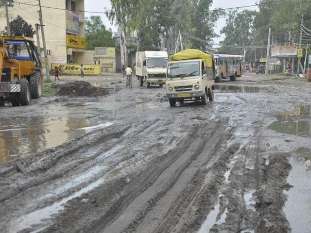 The Jalandhar-Kapurthala road in a dilapidated condition at Basti Bawa Khel. This stretch is to be converted into a four-lane road.