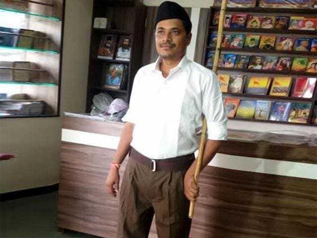 An RSS member poses for a photo in Nagpur.