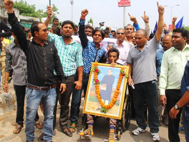 Dalits shout slogans during a protest march from Ahmedabad to Una where four Dalits were beaten