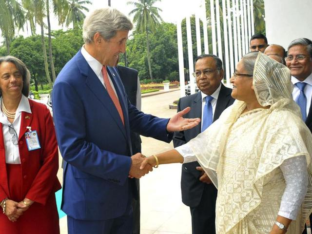 US secretary of state John Kerry and Bangladesh Prime Minister Sheikh Hasina pose for a photograph during a meeting in Dhaka on Monday. Kerry held talks with Hasina on combatting extremism days after police killed members of an Islamist group blamed for a deadly cafe siege.
