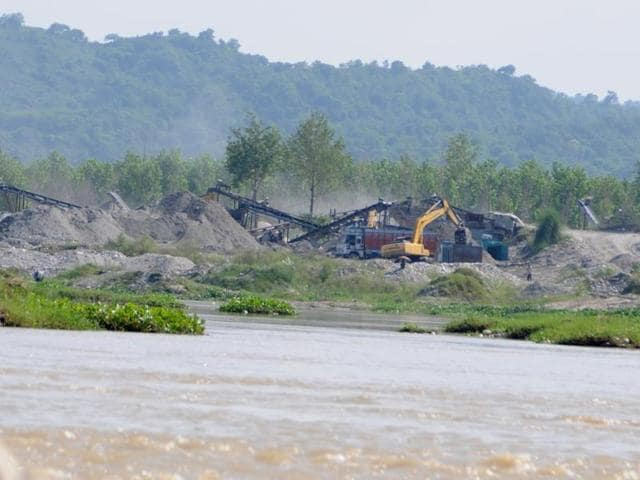 Sand being mined along the Sutlej at Nangrah near Nangal in Rupnagar district.